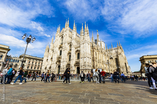 Canvas Milan Tourists are relaxing in fornt of Duomo Italy with blue sky and cloud