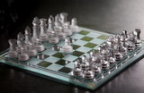 Glass pieces and chess board