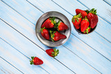 Strawberries on wooden table - 205635872