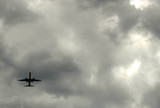 airplane in storm clouds