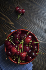 Cherries. Cherry. Cherries in color bowl and kitchen napkin.