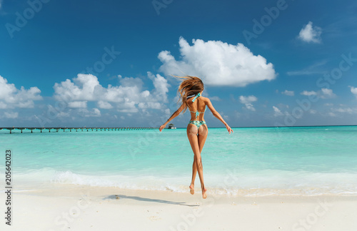 Foto Murales sexy woman with perfect body in luxurious swimming suit relaxing on Maldive island