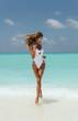 sexy girl with blond hair in luxurious bikini relaxing on Maldive island