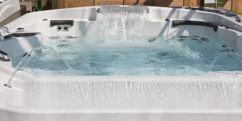 garden home spa detail isolated and falling water jet