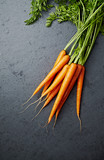 Bunch of Fresh Organic Carrots on stone background - 205654430