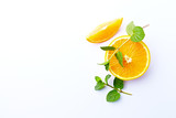 Fresh Orange and Mint Leaves on White Background - 205654469