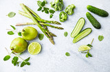 An Arrangement of Green Vegetables,  Fruits and Herbs; asparagus, broccoli, cucumber, pears, lime, mint; flatlay - 205654482