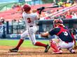 Leinwanddruck Bild - baseball player hitting and sliding