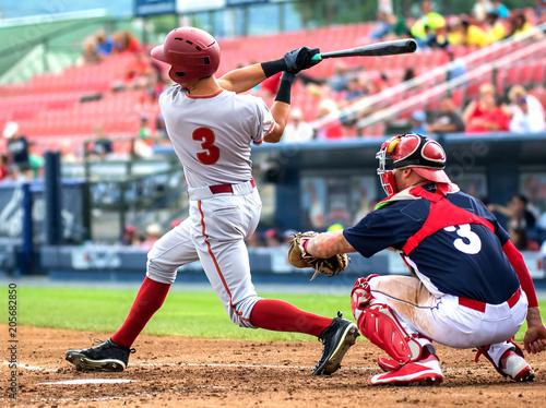 Leinwanddruck Bild baseball player hitting and sliding