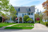 Front view of traditional colonial home with blue shutters - 205705642