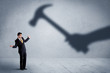 Leinwanddruck Bild - Business person afraid of a shadow hand holding hammer concept on background