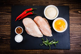 Raw chicken fillet on wooden table  - 205722204