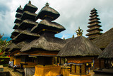 Main Bali temple Pura Besakih at the foot of the volcano Agung. Balinese sacred mountain Agung colored in pink by sunset light. The must visit religious landmark of Bali in the evening.