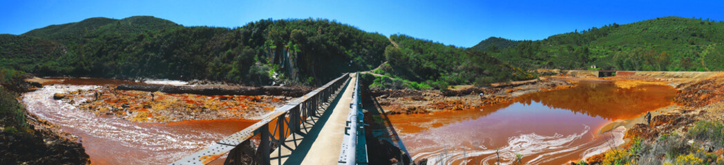 Panoramic view of the iron bridge of Cachan, which passes over the river Odiel, near the mines of Riotinto in the province of Huelva, Spain