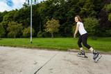 Girl rollerblading - 205738675