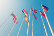 Bottom view of a flags of different countries of the world against a sunlight in the clear blue sky (toned)