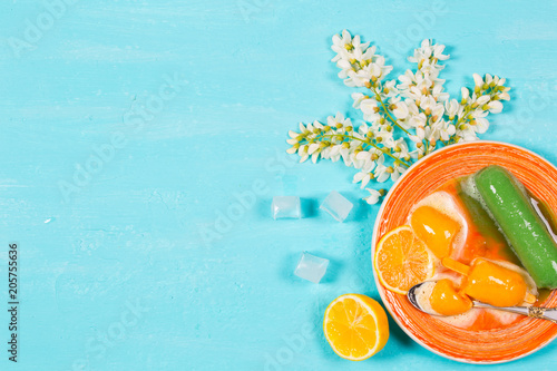 Ice cream melts on an orange plate