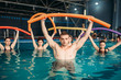 Quadro Instructor and class on workout in swimming pool