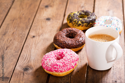 cup of coffee with donuts