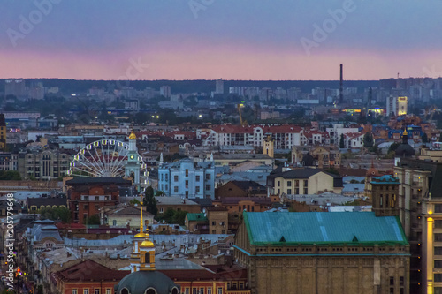Historical centre of Kiev. Tourist destination. Cityscape of Kiev, capital of Ukraine. Evening landscape of Podil. Ferris wheel