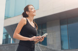 Woman choose music to listen during workout - 205781283
