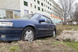 Russia, Murmansk - may 19, 2018: Clunkers. Disassembled abandoned car is on the street of the city.