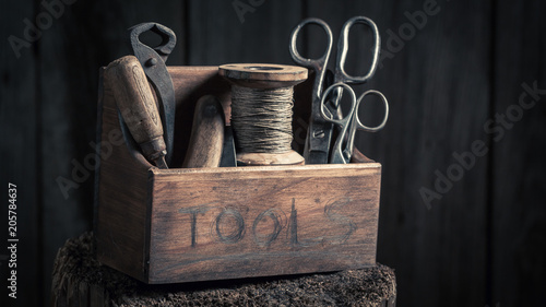 Retro small box of tools in wooden workshop