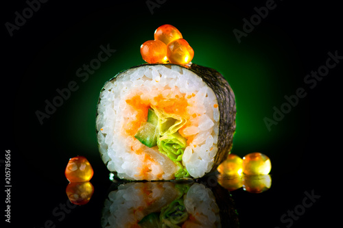 Fotobehang Sushi bar Sushi roll over black background. Sushi roll with tuna, vegetables, flying fish roe and caviar closeup. Japanese food