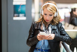 Woman listening to music at the station - 205795072