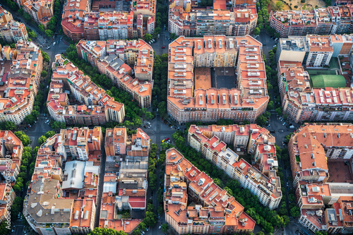 Barcelona architecture, high angle view of the city typical urban grid, Spain. Aerial helicopter view