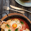 top view of delicious fried eggs, sauce, cheese and fork with knife on wooden table - 205808067