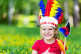 little funny girl playing native american in summer park - 205824069