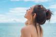Quadro Beautiful young woman in sexy bikini standing at sea beach