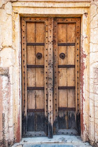 Antique rustic ancient wooden door. Architectural element.