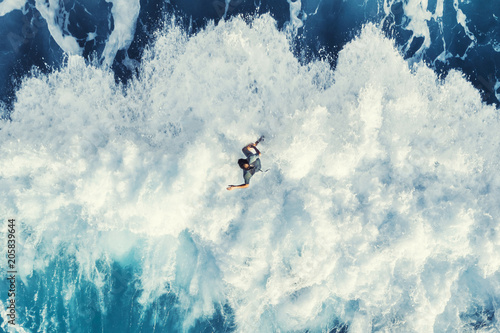 Fototapeta Surfer on the big wave, top view