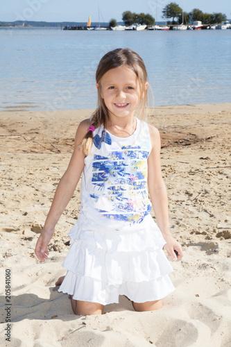 charming beauty girl play on sand beach