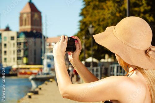 Sticker Beautiful elegant woman taking pictures with camera