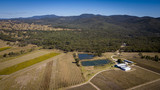 Aerial drone view over wineries and granite rock in Stanthorpe, Australia - 205850632