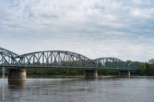 Fototapeta Truss road bridge over Vistula river in Torun, Poland.