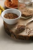 Coriander seeds spice on wood - 205854013