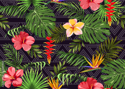 Seamless pattern with exotic flowers and tropical leaves © Hmarka