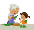 Grandmother and granddaughter cook togher national Chinese food zongzi, which eat in Dragon boat festival