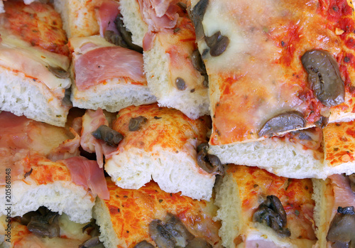 Plexiglas Pizzeria slices of pizza with mushrooms and ham prepared for a buffet
