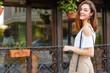 Young beautiful caucasian woman posing outdoor in the city