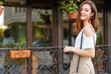 Young beautiful caucasian woman posing outdoor in the city - 205888060