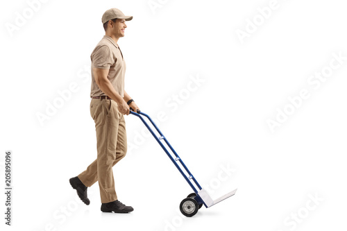 Delivery man pushing an empty hand truck