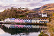 Reflections of Coloured houses in harbour, Portree, Scotland