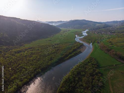Fotobehang Bergrivier beautiful landscape. sunset over carpathian mountains. aerial view