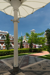 Small park in Front of the Jamek mosque with sun protection to rest.