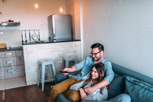 Young couple watching tv.